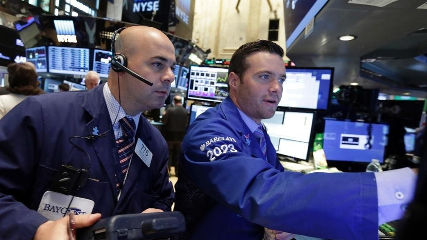 Trader Fred DeMarco, left, and specialist Frank Masiello work on the floor of the New York Stock Exchange Thursday, May 21, 2015. U.S. stocks edged higher in early trading. Energy stocks rose more than the rest of the market as the price of oil climbed. (AP Photo/Richard Drew)