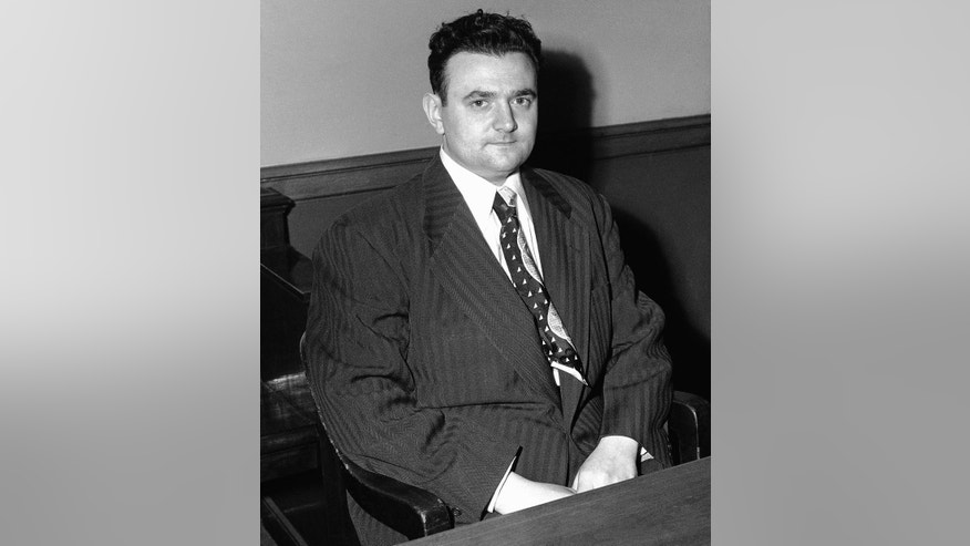 FILE- In this March 12, 1951 file photo, David Greenglass, one-time Los Alamos atom bomb project employee, is shown in Federal Court in New York in handcuffs. He testified against his sister and two others accused of passing atomic secrets to Russia. A New York judge has ordered the release of Greenglass's grand jury testimony from 1950, that may give new fuel to suspicions that his sister, Ethel Rosenberg, was unjustly convicted of espionage and put to death for conspiring to give nuclear secrets to the Soviet Union. (AP Photo/Tom Fitzsimmons, File)