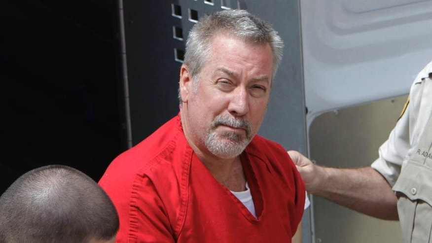 FILE - In this May 8, 2009 file photo, former Bolingbrook, Ill., police officer Drew Peterson arrives for court in Joliet, Ill. A state appeals court is hearing arguments Thursday, May 21, 2015 in Ottawa, Ill., from lawyers seeking to overturn Peterson's murder conviction in his third wife's 2004 death. The Chicago Tribune reports that attorneys for Peterson are challenging his 2012 conviction. They claim prosecutors shouldn't have been allowed to present second-hand evidence and Peterson's previous lawyer provided ineffective counsel. Peterson is serving a 38-year sentence for killing Kathleen Savio, and is a suspect in the disappearance of his fourth wife, Stacy Peterson. (AP Photo/M. Spencer Green, File)
