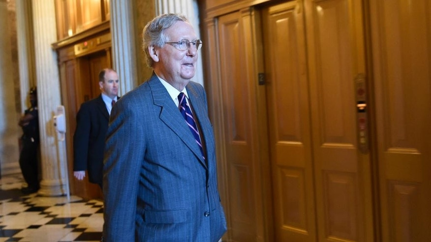 Senate Majority Leader Mitch McConnell of Ky. walks to a Republican luncheon on Capitol Hill in Washington, Friday, May 22, 2015. Supporters of President Barack Obama's trade agenda hope to fend off hostile Senate amendments Friday and send a major trade bill to the House, where another fierce debate awaits. Senators also plan to address the government's soon-to-expire authority to collect bulk data on Americans' phone records. (AP Photo/Susan Walsh)