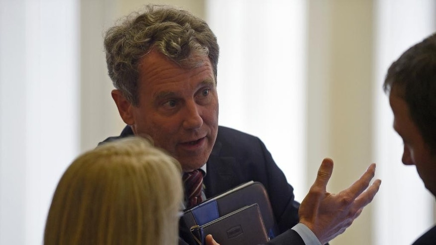 Sen. Sherrod Brown, D-Ohio, center, talks with Sen. Patty Murray, D-Wash., left, before the start of a meeting with Senate Democrats on Capitol Hill in Washington, Friday, May 22, 2015. Supporters of President Barack Obama's trade agenda hope to fend off hostile Senate amendments Friday and send a major trade bill to the House, where another fierce debate awaits. Senators also plan to address the government's soon-to-expire authority to collect bulk data on Americans' phone records. (AP Photo/Susan Walsh)