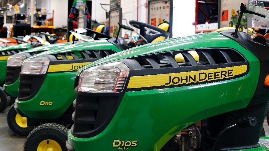 In this March 23, 2015 photo, John Deere lawn tractors are on display at a Home Depot in Robinson Township, Pa. Deere & Co. on Friday, May 22, 2015, reported fiscal second-quarter earnings of $690.5 million. (AP Photo/Gene J. Puskar)