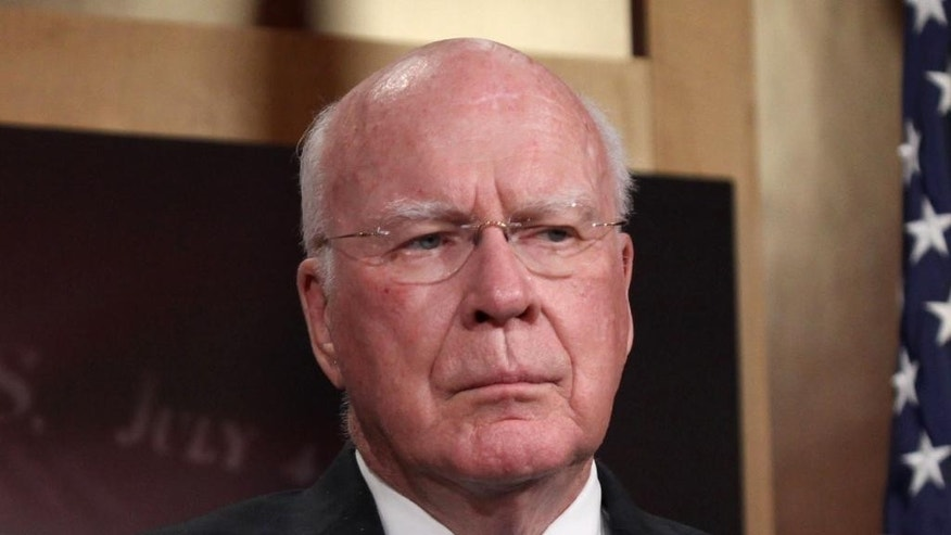 FILE - In this April 23, 2015 file photo, Sen. Patrick Leahy, D-Vt. listens during a news conference on Capitol Hill in Washington. Congress' debate over domestic surveillance is scrambling partisan divisions in the Senate as libertarian-minded Republicans defy their leaders to make common cause with liberal Democrats.  (AP Photo/Lauren Victoria Burke, File)