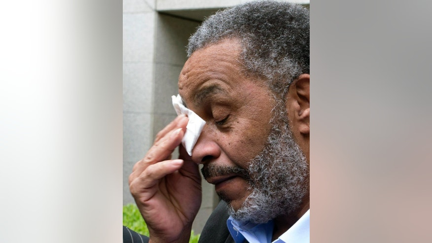 FILE -In this Friday, April 3, 2015 file photo, Anthony Ray Hinton wipes away tears after greeting friends and relatives upon leaving the Jefferson County jail, in Birmingham, Ala. Hinton spent nearly 30 years on Alabama's death row.  Hinton was freed last month after new ballistics tests contradicted the sole evidence used convict him of two Birmingham murders. He says he is trying to let go of the anger because hatred, he said, will keep him in a different sort of prison. (AP Photo/ Hal Yeager, File)