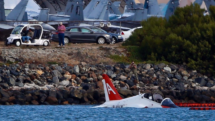 May 22, 2015: A US Navy aircraft sits in shallow water in San Diego Bay after over shooting a runway at the North Island Naval Station.