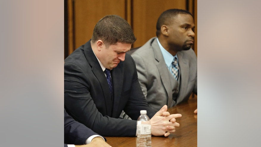 Michael Brelo weeps as he hears the verdict in his trial Saturday, May 23, 2015, in Cleveland. Brelo, a patrolman charged in the shooting deaths of two unarmed suspects during a 137-shot barrage of gunfire was acquitted Saturday in a case that helped prompt the U.S. Department of Justice determine the city police department had a history of using excessive force and violating civil rights. (AP Photo/Tony Dejak)