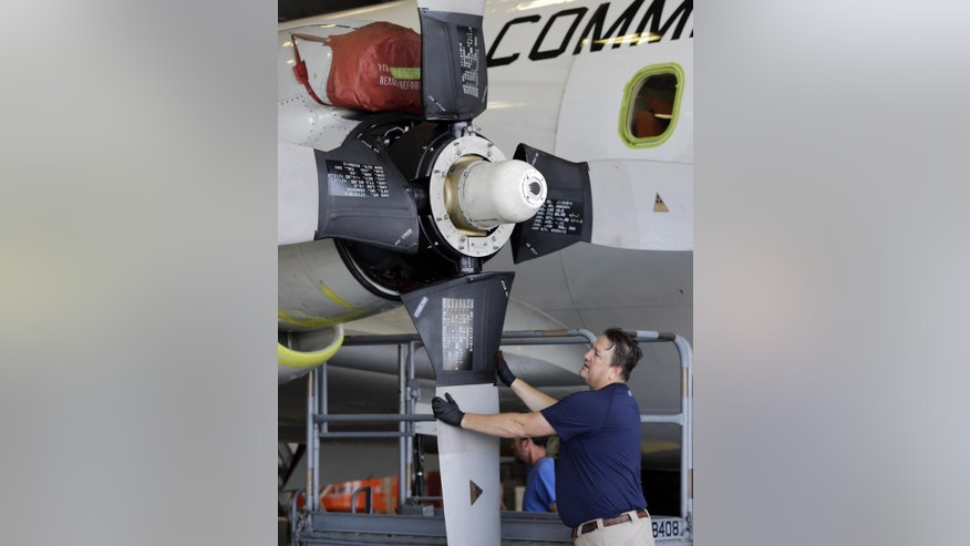 "Chris LaLonde works on the the engines on the National Oceanic and Atmospheric Administration's P-3 turboprop aircraft ""Miss Piggy"" Friday, May 15, 2015, at MacDill Air Force Base in Tampa, Fla. While best known as ""hurricane hunters,"" NOAA's four-engine WP-3D turboprops support a wide variety of national and international meteorological, oceanographic, and environmental research and monitoring programs in addition to hurricane research and reconnaissance. Projects range from air chemistry, climate, and ocean heat content studies to satellite data validation. (AP Photo/Chris O'Meara)"