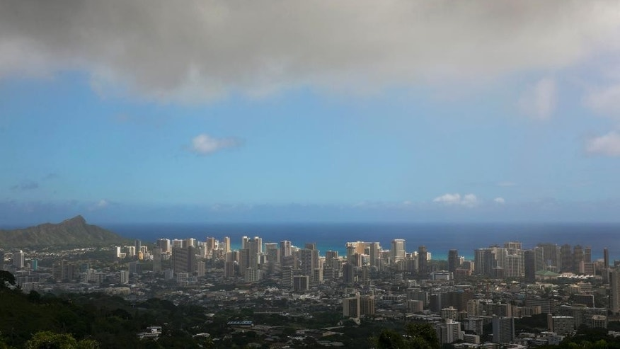 In this Aug. 7, 2014, file photo, clouds hang over Honolulu as Hurricane Iselle approaches. The National Oceanic and Atmospheric Administration's Central Pacific Hurricane Center says the 2015 hurricane season in the region will see more storms than average from June 1 through Nov. 30. (AP Photo/Marco Garcia, File)
