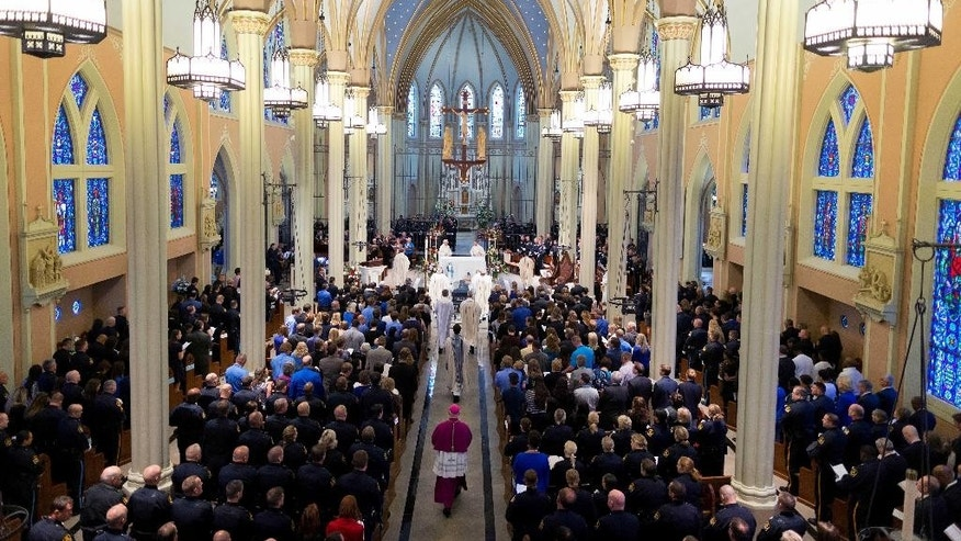 Mourners fill the church for the funeral of  Omaha police detective Kerrie Orozco at St. John's Catholic Church at Creighton University, Tuesday, May 26, 2015 in Omaha, Neb. Orozco was shot to death Wednesday by a fugitive who was fatally wounded by another officer. (Matt Miller/The World-Herald via AP, Pool)