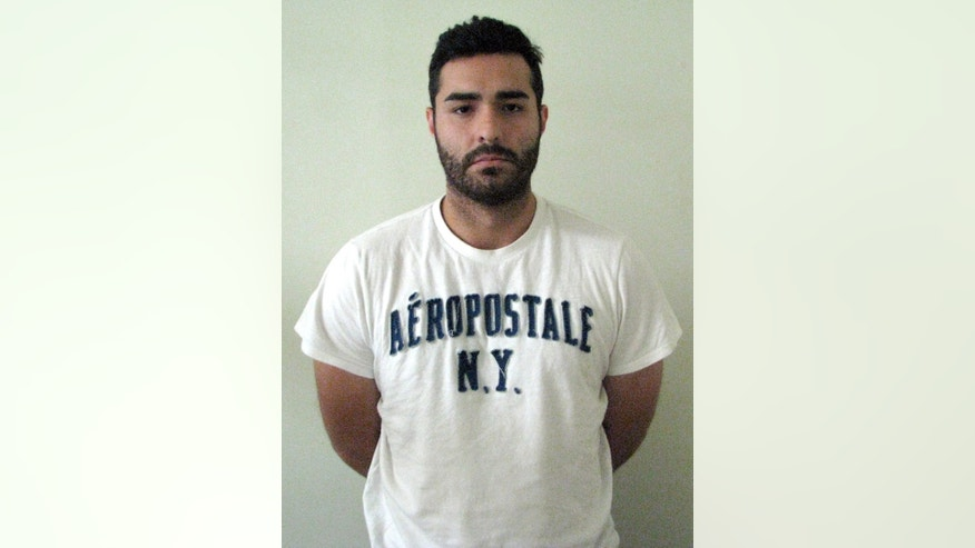 "In this photo provided by Mexico's attorney general's office, shows fugitive former Los Angeles police officer Henry Solis, 27, after he was captured by Mexican security forces in the border city of Ciudad Juarez, Mexico, Tuesday, May 26, 2015. Solis was charged with killing a man during an off-duty fight outside a nightclub in Pomona, California on March 13. ""Henry Solis will be put at the disposition of Mexico's migration office so that he can be handed over to the appropriate authorities,"" a statement from the office said. (Mexico's Attorney Generals Office via AP)"