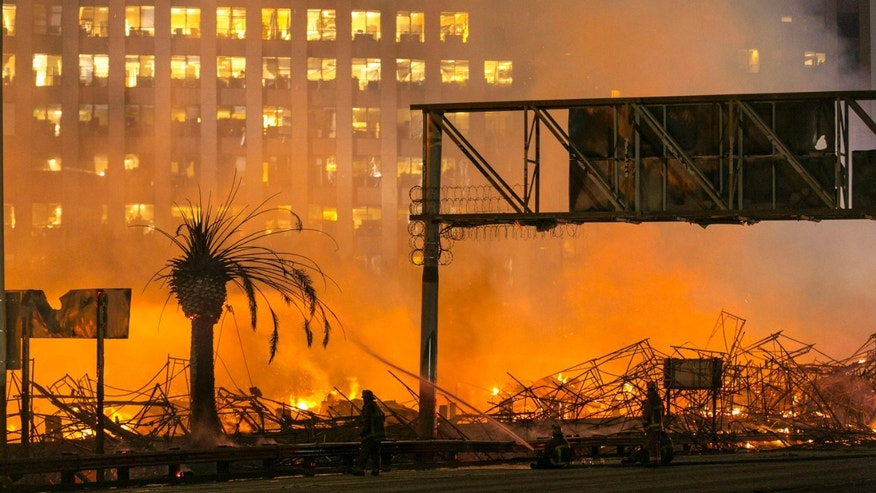Dec. 8, 2014: In this file photo, Los Angeles firefighters battle a fire at an apartment building under construction next to the Harbor Freeway (Interstate 110) Freeway in Los Angeles.