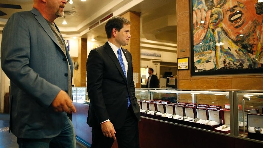 Republican presidential candidate Sen. Marco Rubio, right, R-Fla., tours the World Famous Gold & Silver Pawn shop with owner Rick Harrison, Thursday, May 28, 2015, in Las Vegas. Harrison is on the television show Pawn Stars. (AP Photo/John Locher)