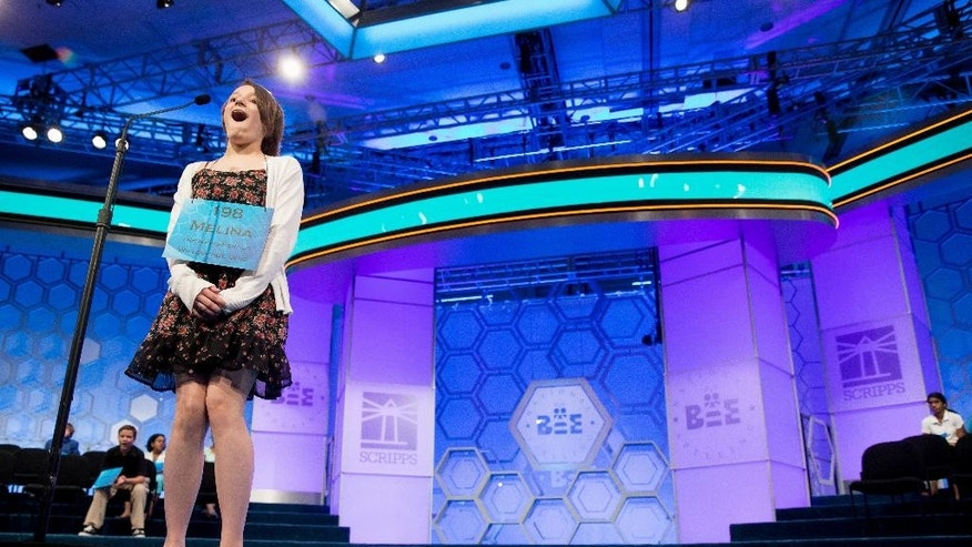 "Melina Gabele, 13, of Willoughby, Ohio reacts as she correctly spells ""schiller"" during the semifinals of the 2015 Scripps National Spelling Bee, Thursday, May 28, 2015, in Oxon Hill, Md. (AP Photo/Andrew Harnik)"