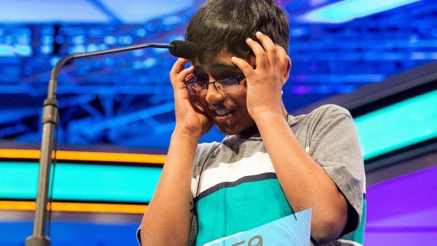 "Srinath Mahankali, 11, of New York, N.Y., stands onstage before correctly spelling ""sphenogram"" during the semifinals of the Scripps National Spelling Bee, Thursday, May 28, 2015, in Oxon Hill, Md. (AP Photo/Andrew Harnik)"