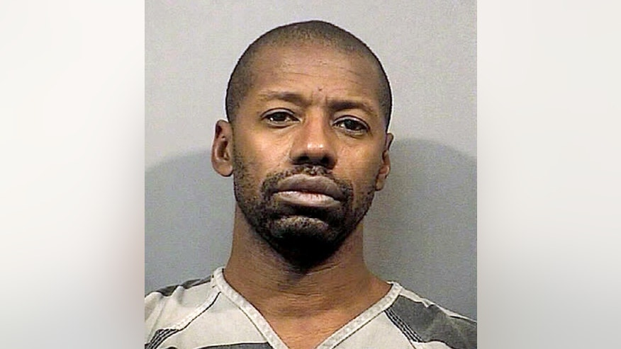 This photo provided May 29, 2015 by the Lake County, Indiana, Sheriff's Department shows  Darren Vann of Gary, Indiana. Vann is charged with strangling two women and suspected of killing five others whose remains were found in October, 2014 in northwest Indiana. (Lake County Sheriff's Department via AP)