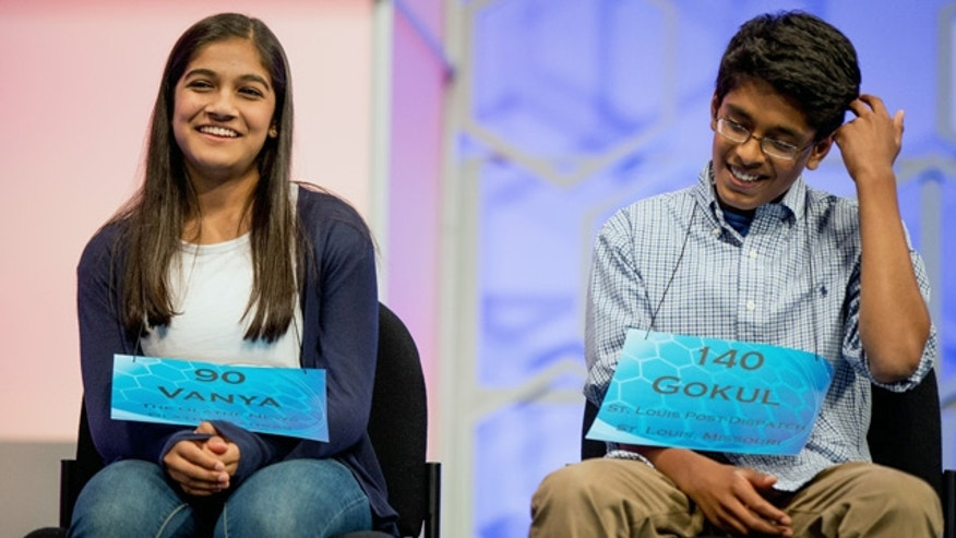 May 28, 2015: Vanya Shivashankar, 13, left, of Olathe, Kan., and Gokul Venkatachalam, 14, right, of St. Louis, sit on stage during the finals of the Scripps National Spelling Bee in Oxon Hill, Md. Both were later declared co-champions. (AP Photo/Andrew Harnik)