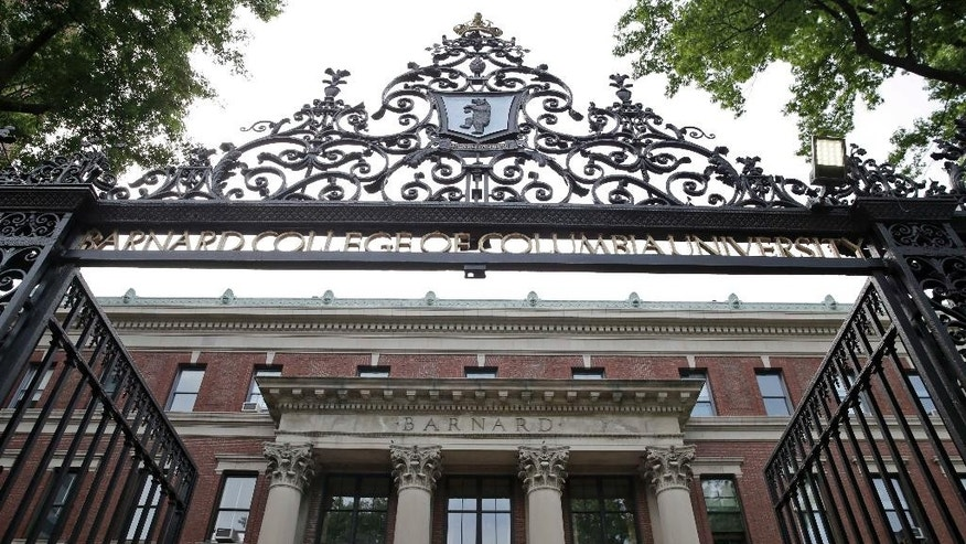 In this Thursday, May 28, 2015 photo, a gate over the entrance of Barnard College is seen in New York. Barnard, like other women's colleges, has always admitted only students born as women, but the class of 2020 may be different. Soon Barnard's trustees vote on whether to officially admit transgender students _ trans women, trans men or those not identifying with either gender _ following new policies announced at several other women's colleges. (AP Photo/Seth Wenig)