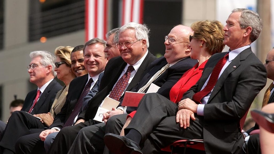 "In this April 20, 2005 file photo, House Speaker Dennis Hastert, center, attends the dedication ceremony for the new Abraham Lincoln Presidential Museum in Springfield, Ill.  Also on the stage are, from left, former Illinois Gov. Jim Edgar, Julie Cellini, U.S. Sens. Barack Obama and Dick Durbin, former Illinois Congressman Ray Lahood, museum director Richard Norton Smith, First Lady Laura Bush and President George W. Bush. A newly unveiled indictment against Hastert released Thursday, May 28, 2015, accuses the Republican of agreeing to pay $3.5 million in hush money to keep a person from the town where he was a longtime schoolteacher silent about ""prior misconduct."" (File/The State Journal-Register via AP)"