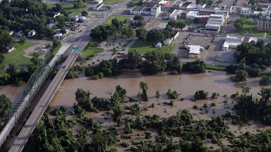 In this aerial photo, the Colorado River flows out of it's banks Saturday, May 30, 2015, in Wharton, Texas. The Colorado River in Wharton and the Brazos and San Jacinto rivers near Houston are the main focus of concern as floodwaters moved from North and Central Texas downstream toward the Gulf of Mexico. (AP Photo/David J. Phillip)