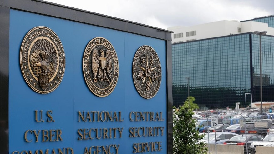 FILE - In this June 6, 2013 file photo, the sign outside the National Security Agency (NSA) campus in Fort Meade, Md. Barring a last-minute deal in Congress, three post 9/11 surveillance laws used against spies and terrorists are set to expire midnight Sunday. Will that make Americans less secure?  Absolutely, senior Obama administration officials say.  Nonsense, counter civil liberties activists.  (AP Photo/Patrick Semansky, File)