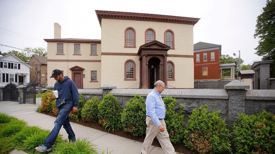 In this Thursday, May 28, 2015 photo, employees Chuck Flippo, right, and Asa Montgomery walk through Patriots Park at the Touro Synagogue, the nation's oldest, in Newport, R.I.  A federal judge has allowed the state of Rhode Island to intervene in a fight over the future of the synagogue by a lawsuit, due for trial Monday, June 1, which pits the nation's first Jewish congregation in New York City against the congregation that worships at the 250-year-old Touro Synagogue.  (AP Photo/Stephan Savoia)