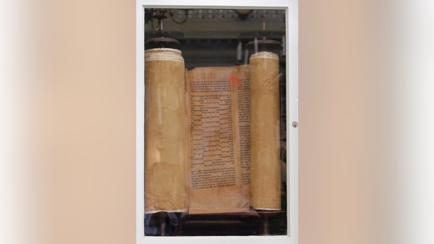 In this Thursday, May 28, 2015 photo, a 500 year-old Torah gifted to the Touro Synagogue, the nation's oldest, is seen in its Ark in Newport, R.I.  A federal judge has allowed the state of Rhode Island to intervene in a fight over the future of the synagogue by a lawsuit, due for trial Monday, June 1, which pits the nation's first Jewish congregation in New York City against the congregation that worships at the 250-year-old Touro Synagogue.  (AP Photo/Stephan Savoia)