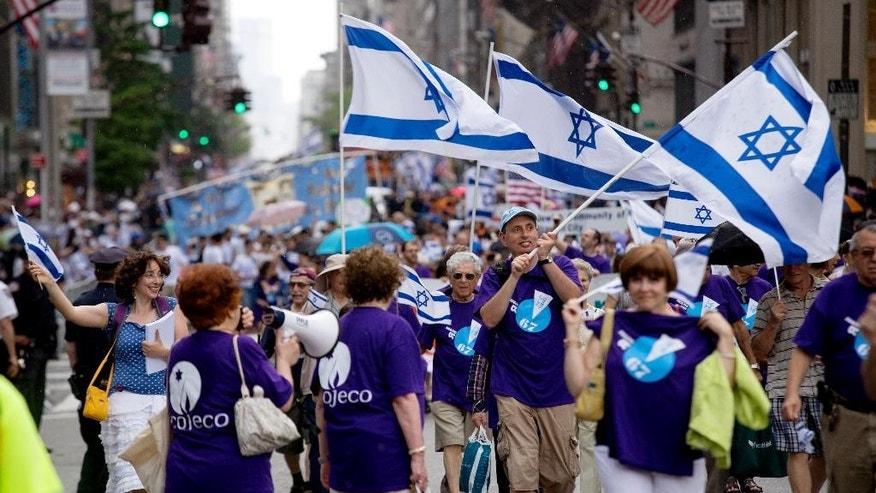 People march along Fifth Ave. during the Celebrate Israel Parade, Sunday, May 31, 2015, in New York. (AP Photo/Craig Ruttle)