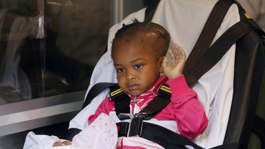 Four-year-old Jacele Johnson, who was shot in the head on May 22 outside a prom party in Chicago's Englewood neighborhood, waves to the media as she is released from Comer Childrens Hospital on Monday, June 1, 2015, in Chicago. Johnson was put in an ambulance that would take her to a Minnesota hospital where she will undergo further treatment.  (Jose M. Osorio/Chicago Tribune via AP) MANDATORY CREDIT CHICAGO TRIBUNE; CHICAGO SUN-TIMES OUT; DAILY HERALD OUT; NORTHWEST HERALD OUT; THE HERALD-NEWS OUT; DAILY CHRONICLE OUT; THE TIMES OF NORTHWEST INDIANA OUT; TV OUT; MAGS OUT; NO SALES