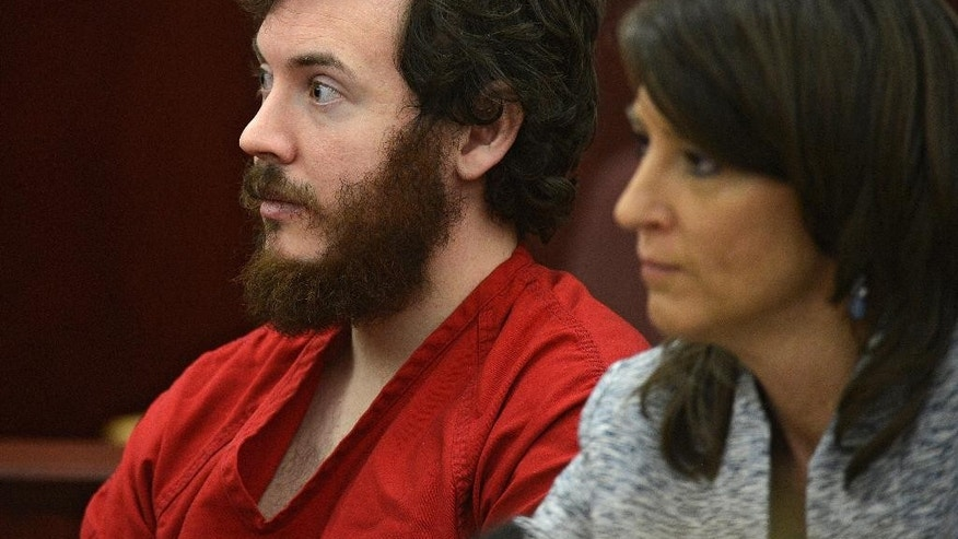 March 12, 2013: In this file photo, James Holmes, left, and defense attorney Tamara Brady appear in district court in Centennial, Colo., for his arraignment.