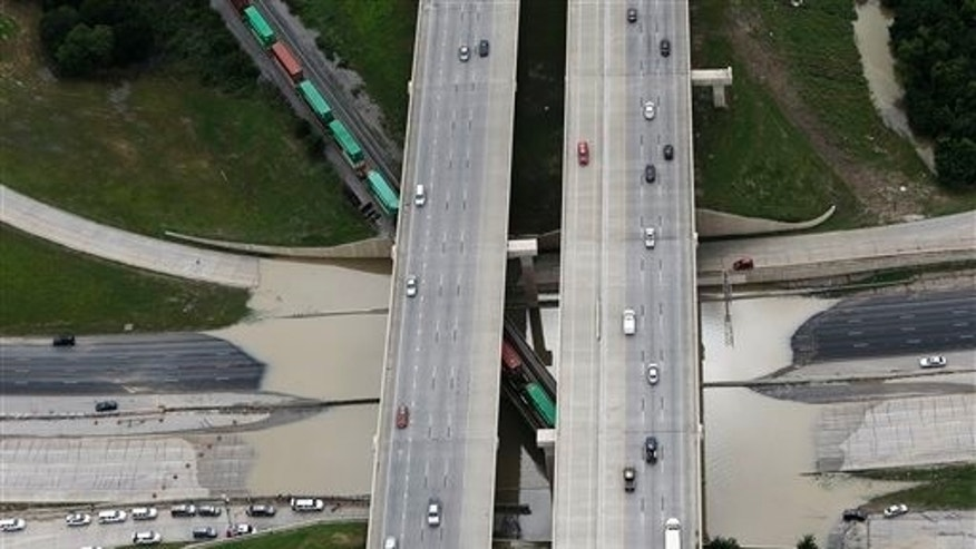 North and south bound Loop 12 at Interstate 30 is shutdown due to high water on the roadway, Friday, May 29, 2015, in Dallas. Floodwaters submerged Texas highways and threatened more homes Friday after another round of heavy rain added to the damage inflicted by storms. (AP Photo/Brandon Wade)