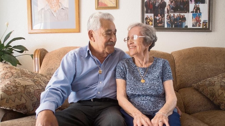 Robert and Ofelia Kirker speak during an interview at their home in Las Cruces, N.M., May 27, 2015. It's been decades since Ofelia Kirker lost her wedding rings, but she'll be wearing the treasured jewelry for her 64th wedding anniversary. The rings were unearthed in a yard there years ago and have finally made their way back to her thanks to an observant yard worker, one woman's sharp memory and her daughter's persistence. (Jett Lowe/Las Cruces Sun-News via AP) MANDATORY CREDIT