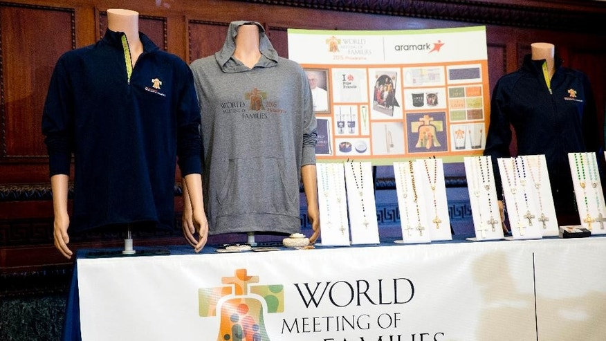 Displayed is merchandise for the scheduled World Meeting of Families Congress and Papal Visit during a news conference, Monday, June 1, 2015, in Philadelphia. Aramark has been named the official retail provider for event merchandise. (AP Photo/Matt Rourke)