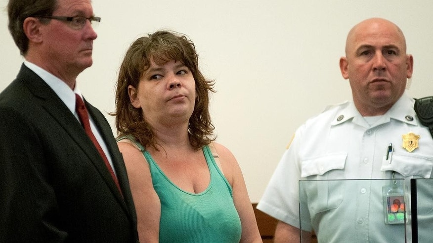 June 1, 2015: Michelle A. Morin, center, is arraigned in Worcester District Court in Worcester, Mass., with her attorney Michael Hussey, left, for the murder of Domingo Ortiz of Worcester, Mass.