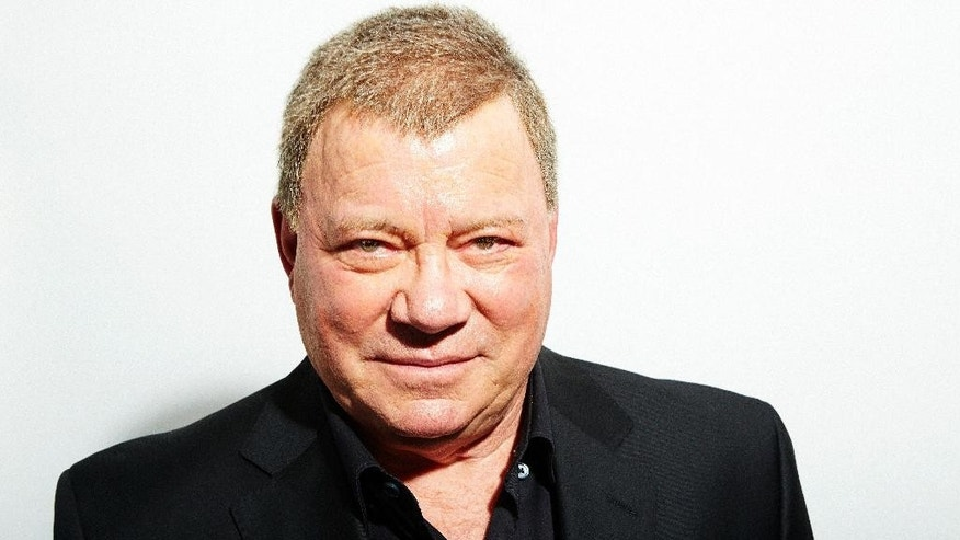 "FILE - In this Oct. 15, 2013 file photo, William Shatner poses for a portrait in New York. The ""Star Trek"" star has partnered with custom motorcycle builder American Wrench to create the Rivet motorcycle.  The eight-day journey will launch June 23, 2015, outside Chicago, Illinois, and make stops in St. Louis and Kansas City, Missouri; Oklahoma City, Oklahoma; Amarillo, Texas; Albuquerque and Flagstaff, New Mexico; and Las Vegas, Nevada; before arriving in Los Angeles, California on June 30. (Photo by Dan Hallman/Invision/AP, File)"