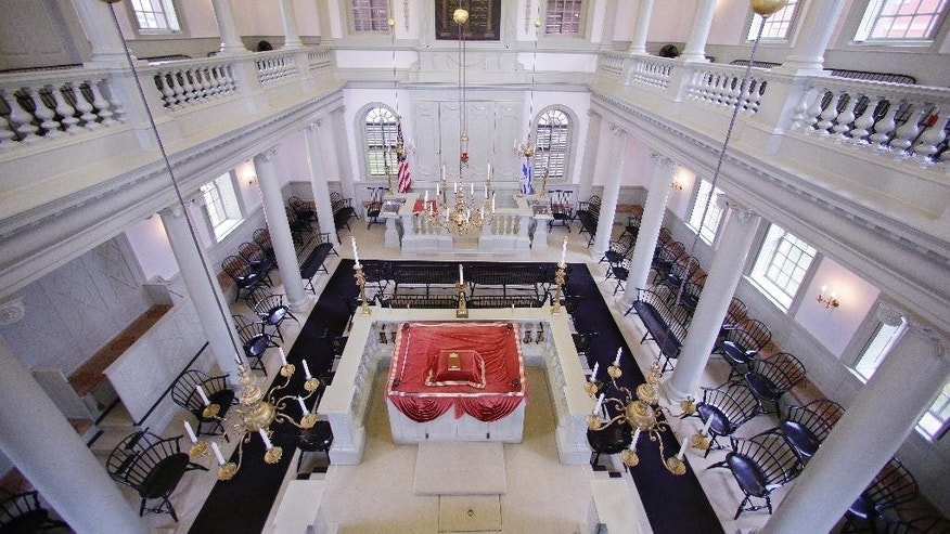 "In this Thursday, May 28, 2015 photo Touro Synagogue, the nation's oldest, is seen from the ""ladies gallery"" in Newport, R.I. Women attend synagogue seated on the second floor while men take their places on the ground floor. A federal judge has allowed the state of Rhode Island to intervene in a fight over the future of the synagogue by a lawsuit, due for trial Monday, June 1, which pits the nation's first Jewish congregation in New York City against the congregation that worships at the 250-year-old Touro Synagogue.  (AP Photo/Stephan Savoia)"