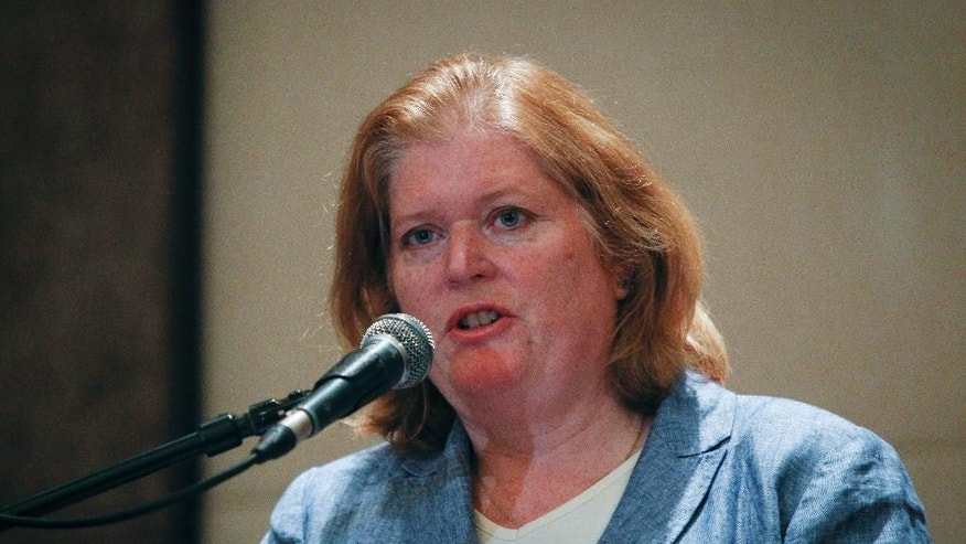 U.S. Assistant Secretary of State for Population, Refugees, and Migration Affairs Anne Richard speaks during a press conference at a hotel in Putrajaya, Malaysia Monday, June 1, 2015. Richard said resettlement in a third country is not the answer to the swelling tide of boat people in Southeast Asia and called for Myanmar citizenship to be given to Rohingya Muslims fleeing persecution there. (AP Photo/Joshua Paul)