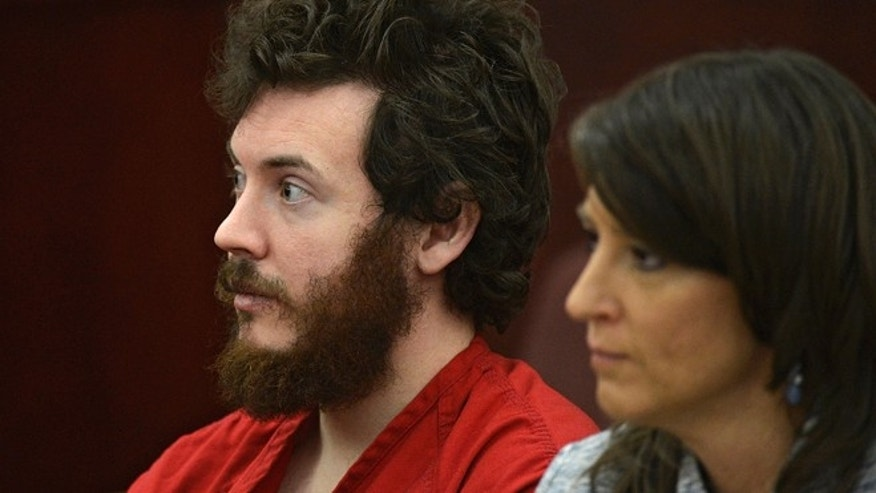 FILE 2013: James Holmes, left, and defense attorney Tamara Brady appear in district court in Centennial, Colo., for his arraignment. Prosecutors are methodically building a case that Holmes knew right from wrong when he planned and carried out the deadly Colorado theater shooting, hoping to convince jurors that he should be convicted and executed and not sent to a mental hospital.