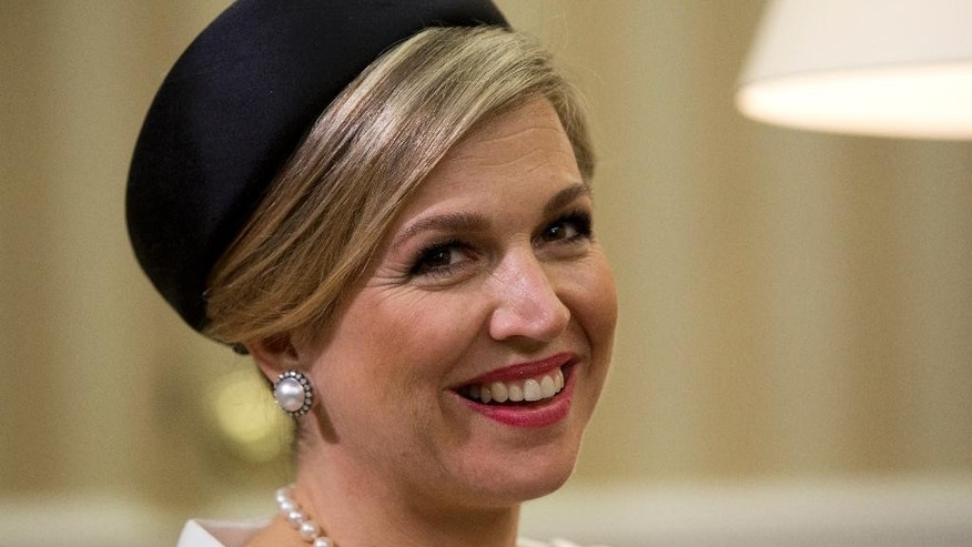 Dutch Queen Maxima smiles as she joins Dutch King Willem-Alexander and President Barack Obama in the Oval Office of the White House in Washington, Monday, June 1, 2015. Their visit reinforces the strong and enduring ties between the United States and the Netherlands that reach back more than 400 years. (AP Photo/Carolyn Kaster)