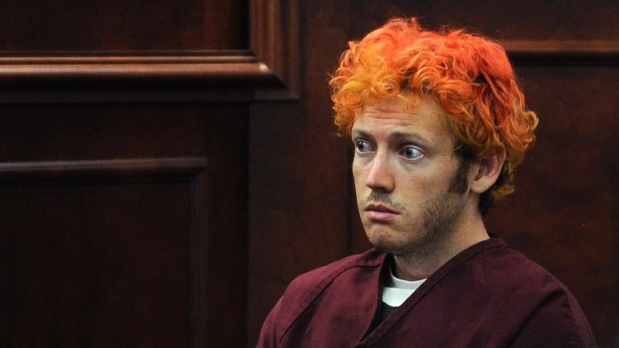 FILE - In this July 23, 2012, file photo, James Holmes, who is charged with killing 12 moviegoers and wounding 70 more in a shooting spree in a crowded theatre in Aurora, Colo., in July 2012, sits in Arapahoe County District Court in Centennial, Colo. In a videotape played for jurors in Holmes' murder trial Tuesday, June 2, 2015, Holmes said that he might not have carried out the attack if his previous psychiatrist, Dr. Lynne Fenton, hadn't prescribed him a drug that reduced his anxiety and fear, but said he might have done it later in life. (RJ Sangosti, Denver Post via AP, Pool, File)