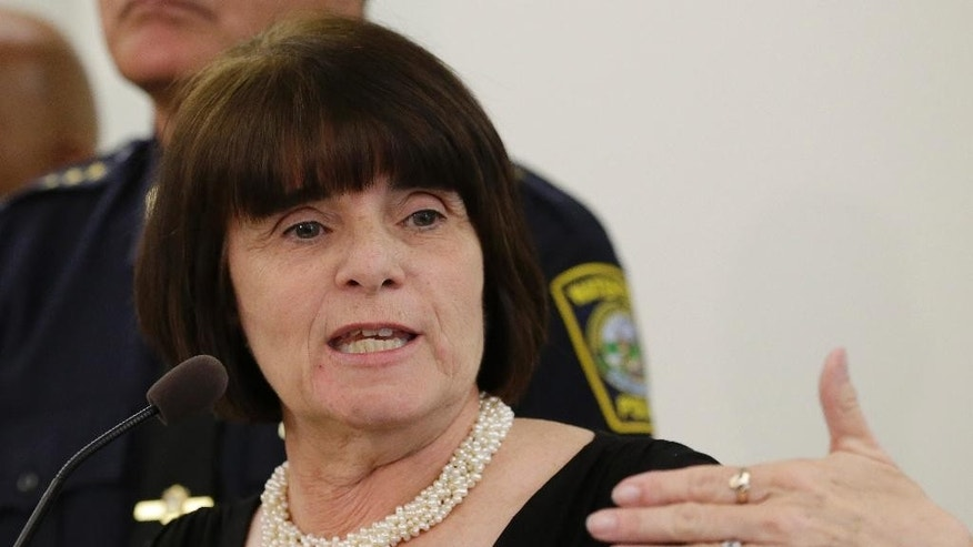 """Middlesex District Attorney Marian Ryan speaks during a news conference Tuesday, June 2, 2015, in Woburn, Mass. A report on a gun battle with the Boston Marathon bombers that took place in Watertown, Mass., in April 2013, said it is """"high likely""""  transit police officer Richard Donohue was critically injured by friendly fire during the gun battle. (AP Photo/Steven Senne)"""