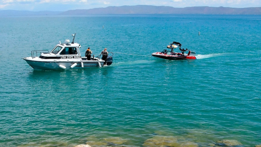 June 2, 2015: Responders tow a boat to the Bear Lake State Park Marina.