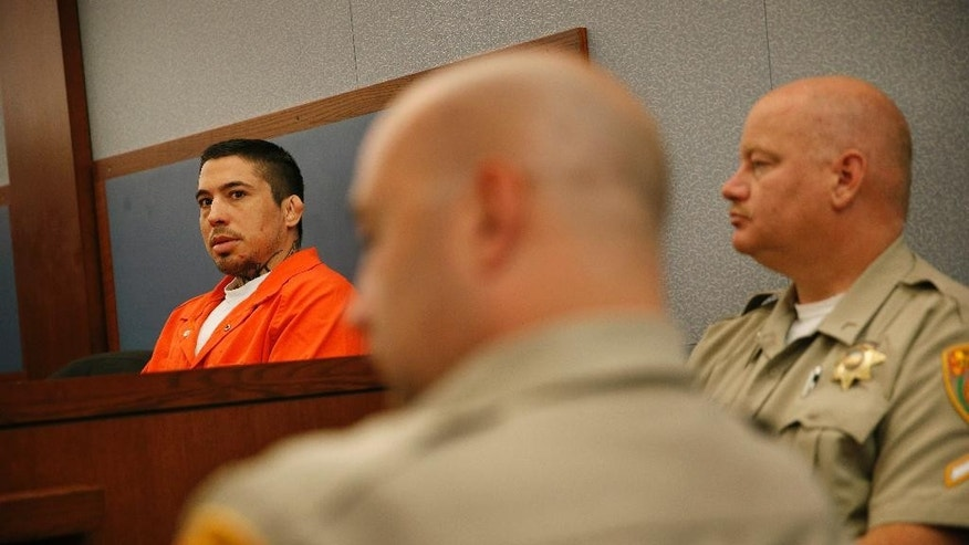 Jonathan Paul Koppenhaver, left, also known as War Machine, appears in court Wednesday, June 3, 2015, in Las Vegas. Koppenhaver is accused of beating and sexually assaulting ex-girlfriend Christy Mack at her home early last August. Mack has agreed to let her name be used in reports about the case. (AP Photo/John Locher)