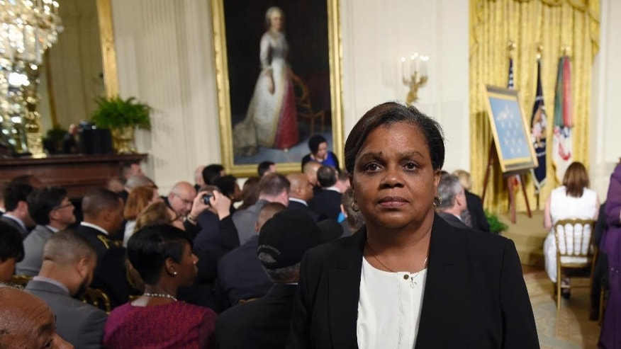 In this June 2, 2015 photo, Tara Johnson, poses in the East Room of the White House in Washington before the Medal of Honor ceremony for the late Army Pvt. Henry Johnson. Two days before President Barack Obama announced a posthumous Medal of Honor for black World War I soldier Henry Johnson, a family got staggering news about the legacy of heroism that had inspired them for generations. A U.S. Army general visited Tara Johnson last month with word Johnson was not her grandfather, World War II Tuskegee airman Herman Johnson was not the hero's son. (AP Photo/Susan Walsh)