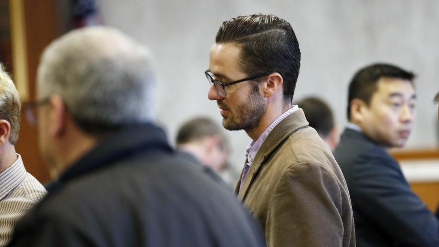 "Plaintiff Michael Ferguson stands in the courtroom during a trial against Jews Offering New Alternatives for Healing, (JONAH) Wednesday, June 3, 2015, in Jersey City, N.J. The nonprofit New Jersey based group that promised to turn gays heterosexual instead offered ""junk science"" and lies, an attorney for four young men told jurors Wednesday during opening statements in the fraud trial involving so-called gay conversion therapy.   (Alex Remnick/The Star-Ledger via AP,  Pool)"
