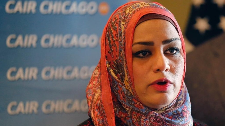 "Muslim chaplain Tahera Ahmad responds to a question during a news conference Wednesday, June 3, 2015, in Chicago.  A Shuttle America flight attendant ""will no longer serve United customers"" following an investigation into the Muslim chaplain's complaint of discriminatory treatment during a flight last week,  an airline spokesman said Wednesday. Ahmad said a flight attendant declined her request for an unopened can of Diet Coke because it could be used as a weapon. The flight was operated by Shuttle America for United. (AP Photo/Christian K. Lee)"