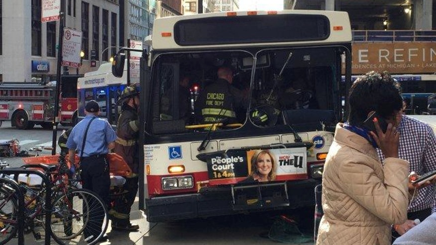 June 2, 2015: Emergency workers board a Chicago Transit Authority bus that jumped the curb, killing one person and injuring eight others in downtown Chicago during afternoon rush hour. (courtesy MyFoxChicago.com)