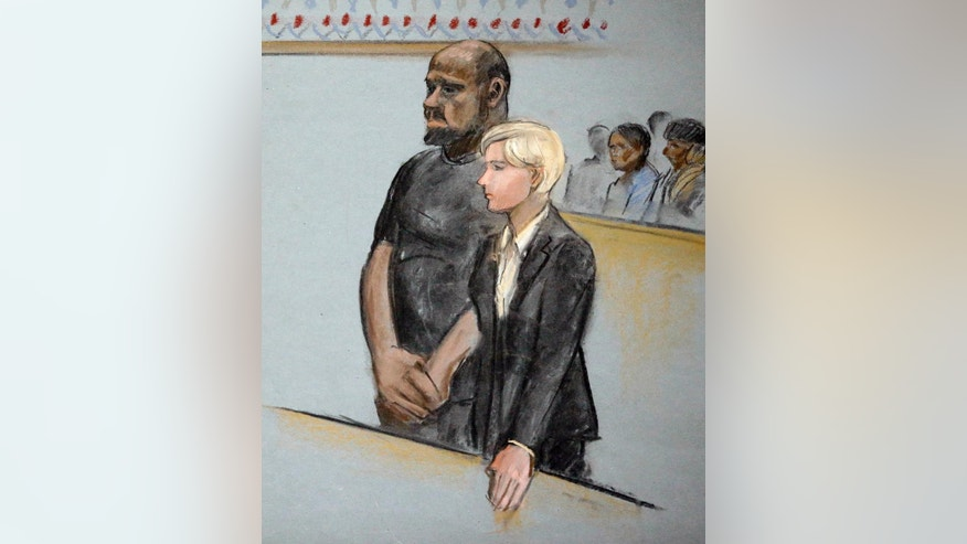 In this courtroom sketch, David Wright, left, is depicted standing with his attorney Jessica Hedges, right, during a hearing Wednesday, June 3, 2015, in federal court in Boston. Wright was ordered held Wednesday on a charge of conspiracy with intent to obstruct a federal investigation in the case of  Usaama Rahim, who while under surveillance by terrorism investigators, was killed after he lunged with a knife at a Boston police officer and an FBI agent. (Jane Flavell Collins via AP)