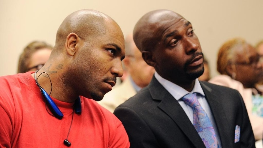 From left, Steven Berry and Alexander Dorsey listen during Mitchelle Blair's  custody hearing before Wayne County Circuit Judge Edward Joseph Thursday, June 4, 2015 in Detroit. Blair was temporarily removed during the custody trial to settle her parental rights to her surviving 8-year-old son and 17-year-old daughter. She was arrested March 24 after court deputies carrying out an eviction at her apartment found the bodies of Stoni Blair, 13, and Stephen Berry, 9, in a deep freezer. Police believe they died months apart in 2012 and 2013.  (Clarence Tabb Jr./Detroit News via AP)  DETROIT FREE PRESS OUT; HUFFINGTON POST OUT