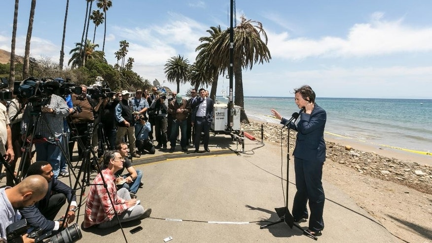California Attorney General Kamala Harris, right, takes questions from the media after being briefed on the oil spill clean up at Refugio State Beach, north of Goleta, Calif., on Thursday, June 4, 2015. (AP Photo/Damian Dovarganes)