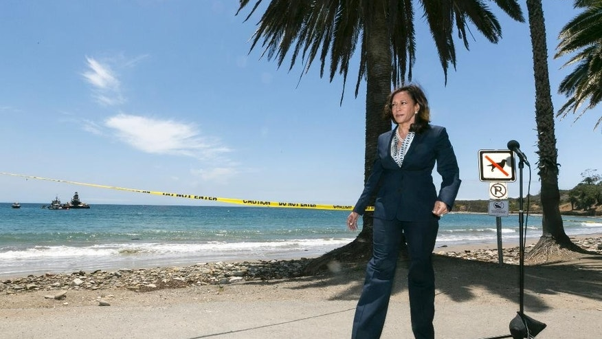 California Attorney General Kamala Harris tours the oil spill clean up at Refugio State Beach, north of Goleta, Calif., on Thursday, June 4, 2015. (AP Photo/Damian Dovarganes)